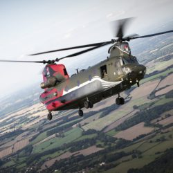 Pictured is a special flight, a Chinook from 18 Sqn, part of the squadrons 100th anniversary celebrations.  On Wednesday 14 September a very special formation left RAF Odiham bound for the south coast of England but tactical camouflage was not on the agenda! In the past 18 months three Chinook aircraft have been painted to celebrate the 100th anniversaries of 18(B) and 27 Squadron from RAF Odiham and 28 Squadron from RAF Benson.   With the first of the helicopters expected to be returned to standard operational markings in the near future this opportunity was integrated in to a formation training sortie which tested the crews' ability to plan and execute some very unique tasks. With it being so complex the mission was, unusually, briefed the day prior to launch and each crew walked through the various maneouvres in the hangar, in what is colloquially known as a 'rock drill.' At the hour they walked for their aircraft each member had a firm grasp of the planned movements which enabled them to focus on maintaining strict safety margins.  The day itself was only the end of a long road though, with preparation having begun over 6 months ago. Operational restraints cancelled the first planned date in June and the only other window where all three aircraft were available concurrently was identified as being this week.   RAF Odiham's dedicated and professional engineering teams were therefore faced with generating three very specific airframes to complete this sortie whilst concurrently deploying multiple others to support exercises in Sweden and onboard HMS Ocean and providing manpower to flying detachments in the United States and elsewhere. They succeeded and the results of their efforts are clearly seen.The Serco team who painted the Chinooks at Odiham, each in the space of two intense weeks, were invited to see the three lined up on the dispersal together for what may be the first and only time – a moment they had waited a long time to see.   As for the stun