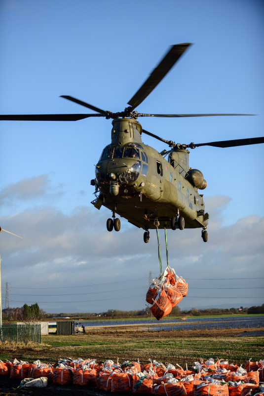 Pictured is an RAF Chinook helping the Environment Agency to bolster the flood defences in a vulnerable area.  As unprecedented flooding spread out over the North of England, the British Army helped the Environment agency and emergency services deal with the difficult situation.